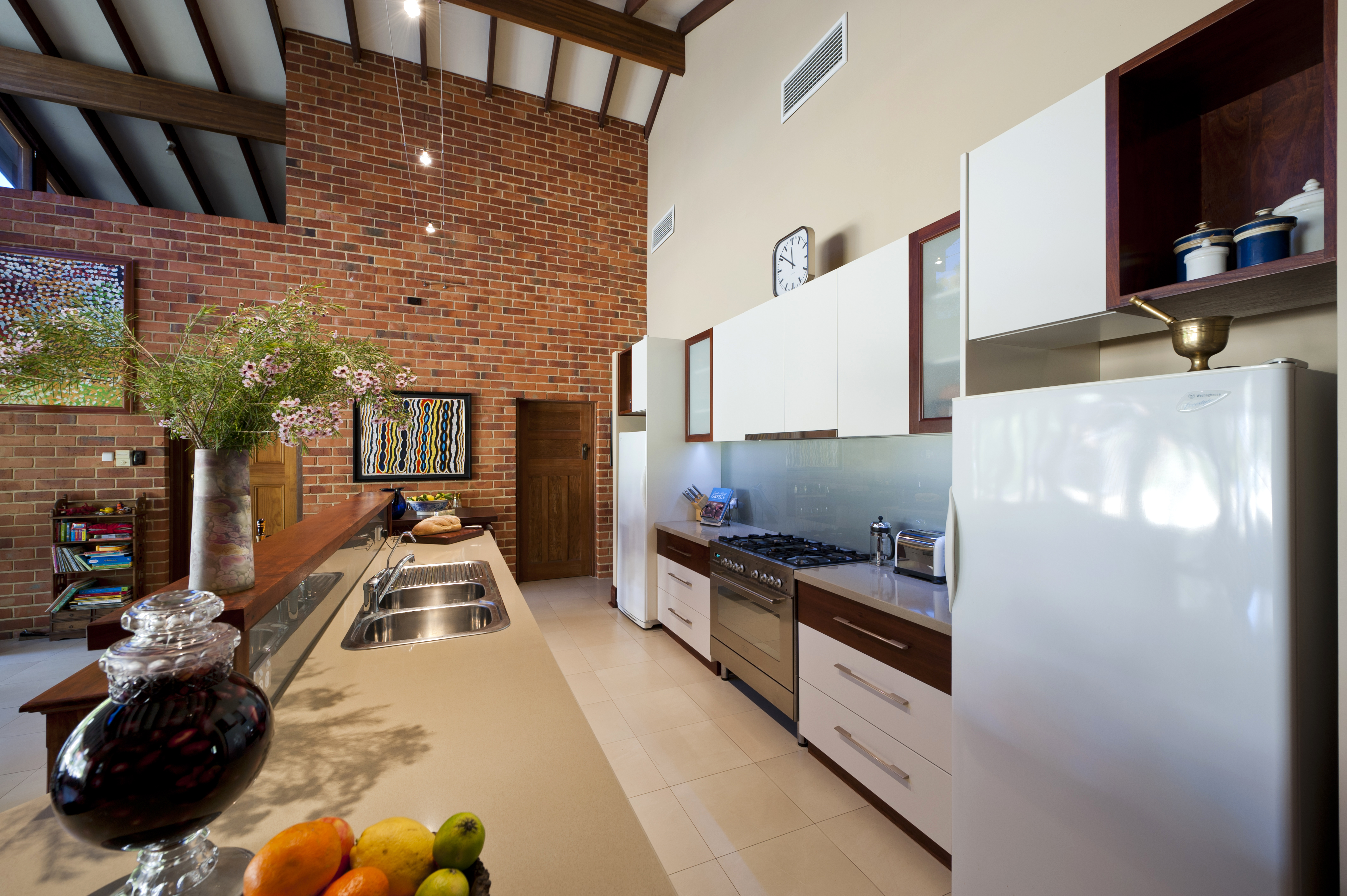 brick wall high ceilings kitchen