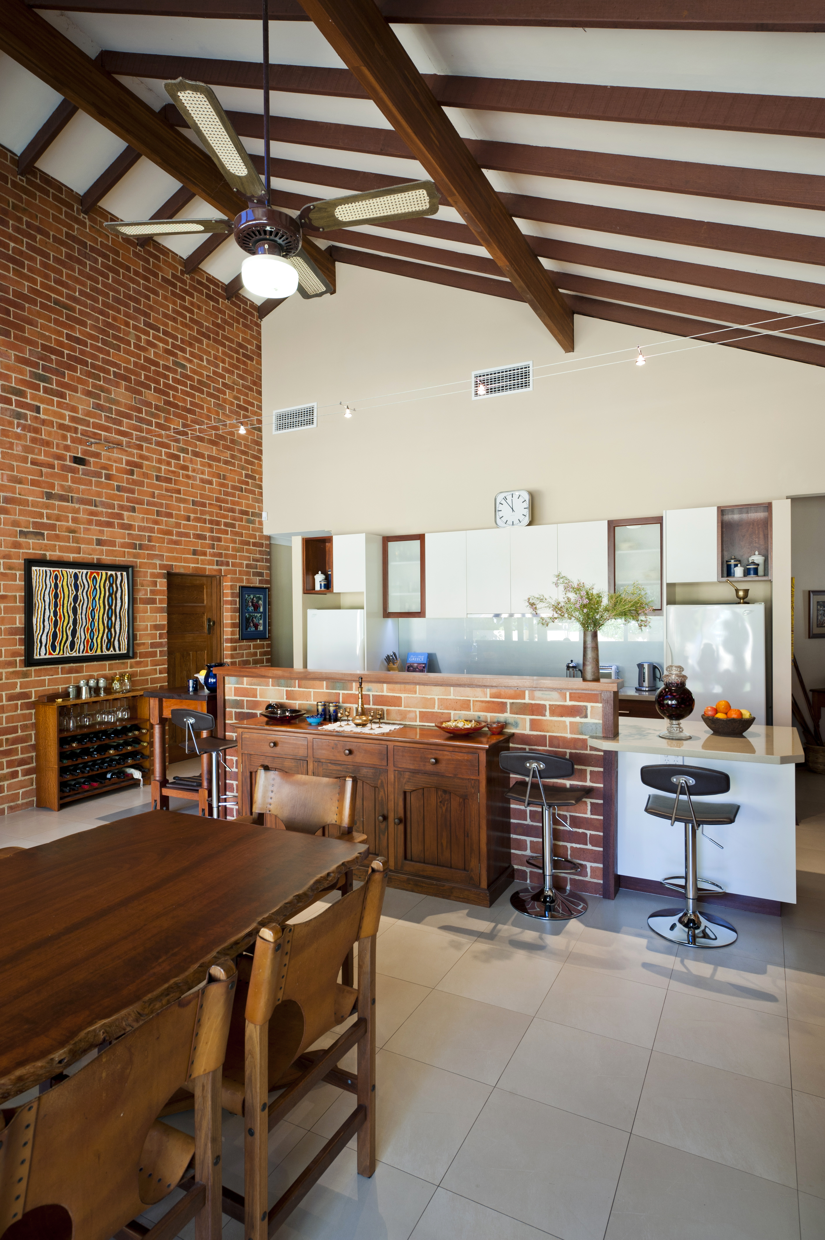 brick wall kitchen dining table high ceilings