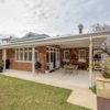 brick veneer home backyard